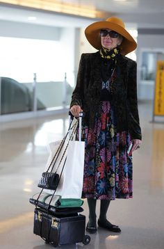"""I saw this woman at the airport on my way from New York to San Diego. I stopped and asked if I could take her photo and she said, """" Yes dear, of course you can, I am in my 80s and everything I have on is from the 70s. I told her that I appreciated how elegantly she was dressed to travel and she quickly replied, """" There is no other way."""""""