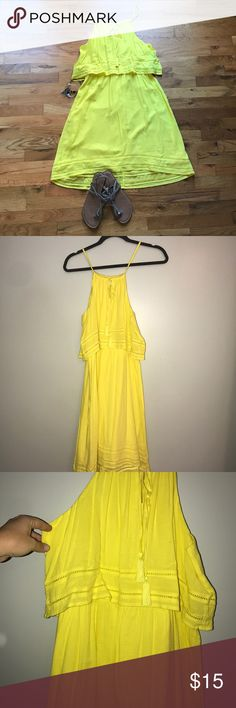 NWOT Crown & Ivy Yellow Dress NWOT Crown & Ivy Yellow Dress size medium. Beautiful dress in a fun bright yellow. Straps can be adjusted with tie at front. Cute tassel detail on front. Dress has lining so it is not see through. Great dress!!! Crown & Ivy Dresses
