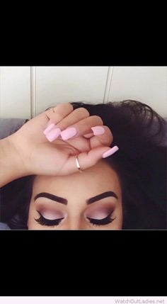 Light pink gel nails and eye makeup