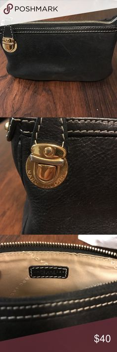 Marc Jacobs leather cosmetic bag Authentic, original Marc Jacobs cosmetic pouch. It's black leather with tan lining and classic MJ gold clip hardware. It is great for throwing in your larger handbag and keeping things organized . Marc Jacobs Bags Cosmetic Bags & Cases