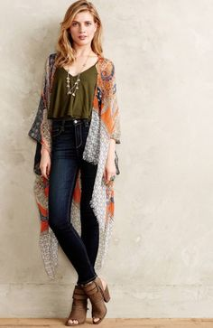 Keep things pretty with a flowy kimono, dark jeans, heeled boots and a contrasting top. (Image via Anthroplogie)