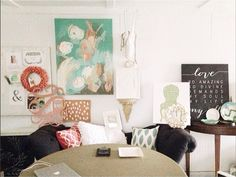 We love everything about this pretty living room, including one of our canvases in the corner!