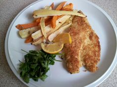 It's dinner time. Oven baked sea bass in breadcrumbs with roasted ...