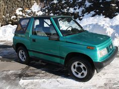 1994 geo tracker.  lol, my first car. But mine was sun-faded red.   aka, my hummer, rollerskate, limo