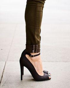 black pumps and olive pants