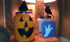 Cheese ball container with crow glued to the top and scrapbook paper for face to make look like a Jack-O-Lantern.  Other made with picture of ghost and filled it with puppy chow recipe and called it Ghost Poop!