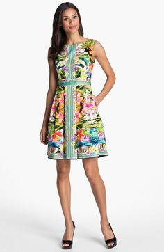 Maggy London Print Cotton Fit & Flare Dress - Contrast trim softens the vibrant tropical print that artfully renders a sleeveless, V-back dress w/ a classically feminine silhouette. Side-seam pockets; hidden back-zip closure;  fully lined; cotton/spandex