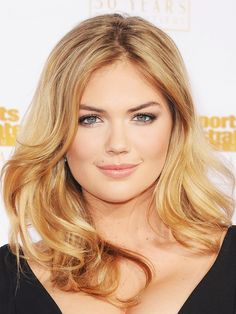 Kate Upton traded her platinum hair and intense eye shadow for a more neutral palette this year.