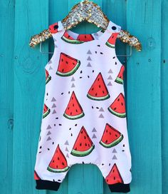 Your little one will be ready for some serious adventures in this toddler romper from Mami's Little Muse. Custom handmade by a seasoned artisan, it features watermelon in a organic modern knit fabric. This designer romper provides oodles of wiggle room for your little muse to crawl and play. It will keep them cool in summer and can be paired with a sweater for those cooler months. It is an original Mami's Little Muse creation. Order now to guarantee availability.*Please read!* To ensure the…