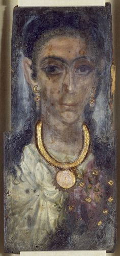 Mummy Portrait of a Woman from Fayum, Egypt. This portrait is on thick wood. The woman wears a necklace and earrings raised in plaster and gilded. There is cloth stuck to the sides and back. Between 130. i 300. (Roman Imperial). encaustic on wood