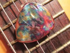 A rainbow copper pick my husband made.  Click on the pick to buy!