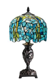 """Following a rich tradition of classic design, this Aztec Lighting Tiffany Aqua Glass Table Lamp will light your home with timeless beauty. Aqua and green mosaic Tiffany glass shade with detailed metal base. Imported. 16.6""""H x 9.2""""W. Sale $91.79"""