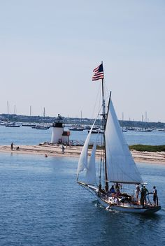 Rounding Brant Point Old Glory waves in the breeze atop a sailboat in Nantucket. ~ (coastal of July, seashore, beach, Independence Day, July Great Places, Places To Go, Brant Point Lighthouse, Les Hamptons, Nantucket Island, Nantucket Cottage, Nantucket Wedding, Nantucket Style, Coastal Living
