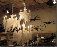 Cheesecloth has so many spooky or ethereal uses at Halloween. It is more substantial than fake spiderwebs, so it can create an entirely different effect.  You can spray your cheesecloth lightly with black or leave it white. But here's a tip when decorating with it: pull & punch tiny holes in the fabric & keep stretching until you get the desired look.