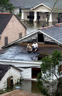 Waiting on rescue.. The water stayed for two weeks.  Charles Evin. Hurricane Katrina in 2005. Influential because many peoples lives were lost and homes were destroyed.