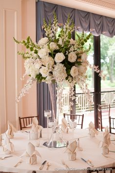 46 tall wedding centerpieces on your big day 36 amazing wedding centerpieces with flowers White Flower Centerpieces, Tall Flower Arrangements, Tall Wedding Centerpieces, Wedding Flower Arrangements, Table Flowers, Wedding Reception Decorations, Centerpiece Ideas, Trumpet Vase Centerpiece, Floral Wedding