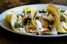 Skillet-Grilled Fish Tacos with Cilantro-Lime Crema (with cabbage and red onion slaw)