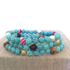 A personal favorite from my Etsy shop https://www.etsy.com/listing/465546075/boho-turquoise-gemstone-beaded-bracelets