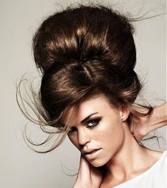 Big Hurr, Don't Curr. A long brown straight coloured beehive updo hairstyle by The Colour Room
