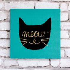 Worried about getting too Catty or Kittenish with your wall art? Well don't! Hang this 12 X 12 blue canvas-over-wooden-frame print with gold foil lettering in your kitchen, bedroom or office. This fli