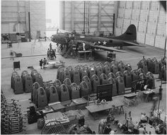 A completed B-17F heavy bomber is checked by final inspectors at the Long Beach, Calif,1942