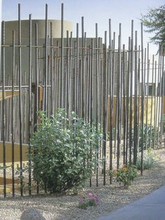 Fence made from steel reinforcing rods. From The room outside