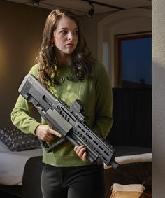 Introducing the TAVOR® IWI US's First Bullpup Shotgun.The tactical-style, gas regulated shotgun features three magazine tubes for a maximum round capacity of 15 rounds plus one. Airsoft Guns, Weapons Guns, Guns And Ammo, Bullpup Shotgun, Tactical Shotgun, Tactical Gear, Tactical Life, Home Defense Shotgun, Armas Ninja