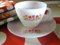 Fire King Tulip Anchor Hocking Milk Glass cup and saucer. In excellent vintage condition with no chips or cracks.