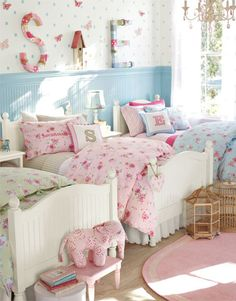 Girls Bedroom. I love that there are 3 beds in a row. Never would have thought to do that.