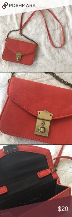 AE Strappy Salmon Cross-Body Super handy and super cute (very lightly used) cross-body from American Apparel with brassy closure and a bit of chain. Fun and FUNctional! straps + body: 100% polyurethane, lining: 60% polyester 40% cotton American Eagle Outfitters Bags Crossbody Bags