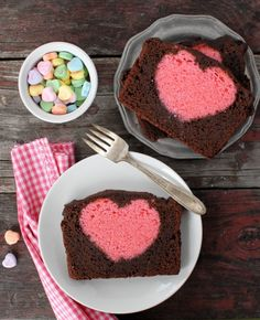 Valentine's Heart Pound Cake. Make the pink cake, cut into pieces and use a cookie cutter to cut each piece into a heart shape. Then put in a pound cake pan, pour the chocolate batter in and bake!