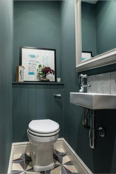 Design & styling by Imperfect Interiors at this lovely house in Tongue & Groove panelling, Fired Earth tiles & Farrow & Ball Inchyra Blue in the downstairs loo.uk Photos by Chris Snook Space Saving Toilet, Small Toilet Room, Guest Toilet, Clockroom Toilet, Bad Inspiration, Bathroom Inspiration, Cloakroom Toilet Downstairs Loo, Small Wc Ideas Downstairs Loo, Understairs Toilet