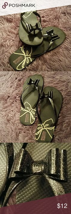 Black bow flip flops Dress up casual with bows! Great shape, shoe has the 4/5 on tjr bottom but I wear an 8 and they fit me. Shoes