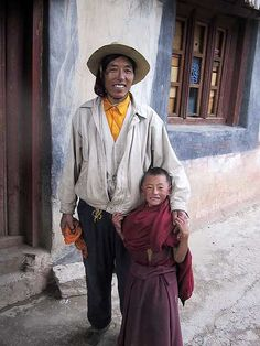 Father and son in Litang, Sichuan province, China