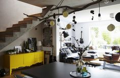 Industrial style, bare branches and woodland motifs combine to create a unique living space