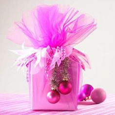 "Pretty ""Hot Pink Christmas"" wrapping with tulle, ribbons and small ornaments! Love this festive, feminine way of wrapping a gift! packaging pink 21 Pink Christmas Decor Ideas That Spread Instant Cheer Creative Christmas Gifts, Christmas Gift Wrapping, Creative Gifts, Christmas Crafts, Christmas Packages, Christmas Ornaments, Merry Christmas, Glass Ornaments, Christmas Presents"