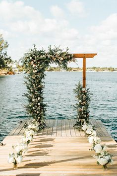This Family-Focused Florida Backyard Wedding Left No Detail Untouched This waterfront ceremony features a romantic asymmetrical flower-filled arch Dock Wedding, Wedding Arch Rustic, Beach Wedding Reception, Lakeside Wedding, Waterfront Wedding, Wedding Ceremony Decorations, Wedding Events, Wedding Backyard, Wedding Ceremonies