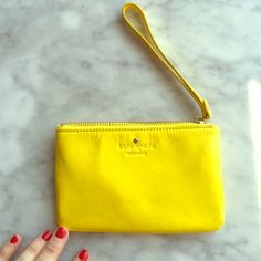 Patent leather bright yellow wristlet. Kate Spade! Kate spade patent leather yellow wristlet. Perfect for summer! Perfect size for credit cards + cash + keys! Never been used. kate spade Bags Clutches & Wristlets