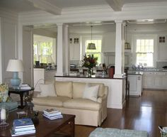 Awesome cape cod style interior design with white wall paint color combine with beige sofa and hardwood flooring