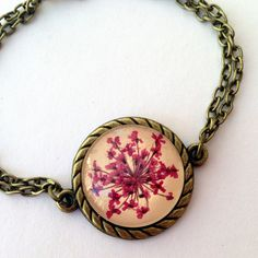 chain bracelet -  fucsia pink flower bracelet- antiqued bronzed with pressed flowers and glass cabochon over beige leather