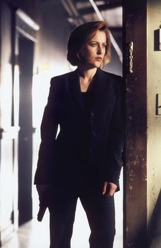 Gillian Anderson as Dana Scully on the X-files. With all the chasing after aliens Agent Scully did on that show, I always thought the FBI should've allowed her to wear sneakers with her black suits. At least her pumps were usually low-heeled!