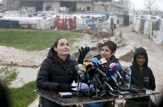 United Nations High Commissioner for Refugees (UNHCR) Special Envoy Angelina Jolie reacts as it rains during a news conference during her visit to Syrian refugees in the Bekaa valley, Lebanon