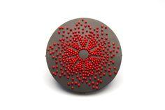 "Julia Turner ""Three Days Walking (Mourning Brooch)"", 2013. Steel pins, vitreous enamel, steel, wood. 2 x 2 x .3 in (5 x 5 x 0.7 cm)."