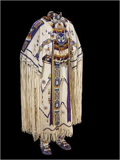A Cheyenne three-hide dress, circa 1995.    A selection of contemporary dresses made by some of the women consulted for the show are notably flashier than the older garments. Often made for powwow dance competitions, these dresses feature precise rows of sparkling cut-glass beads and dizzyingly intricate, modernized patterns.