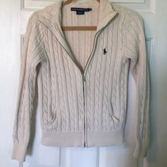 Ralph Lauren Zip Up Ralph Lauren Zip up. Beautiful vanilla color. In excellent condition. Tag says medium but it fits more like a small. Offers are welcome! Ralph Lauren Sweaters