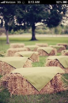 Hay bales for seating at the ceremony. Cover them with the same plaid as the table cloths