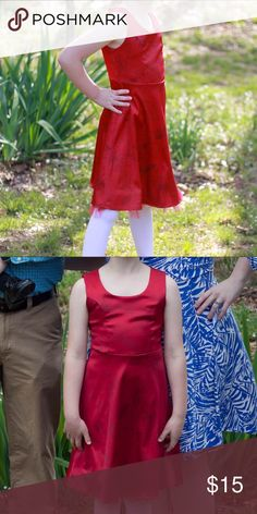 Gorgeous red dress for little girls Red Jonathan Martin brand dress with black flower outlines. Looks fancy, but has some stretch, so it is comfy. Light tuelle protrudes from bottom of the skirt. My daughter wore it all day for Easter and was very comfortable in it, and she usually does not like fitted clothing or dresses. Jonathan Martin Dresses