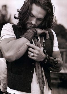 Mr. Momoa shows a tattoo, hard to read but possibly in French... [L'uomo Vogue photos by Bruce Weber -- more at click]