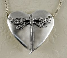 Sterling Silver Dragonfly Heart Aromatherapy Pendant : The Silver Dragon - Sterling Silver New Age Jewelry, The Silver Dragon - Clever Sterling Silver Jewelry designed and created in Rhode Island by talented Silversmiths. Items include: Wiccan Silver Jewelry, New Age Aromatherapy Products, Earrings, Bracelets, Pendants, Rings, Ear Wraps, Rune Products, and Gay Pride Jewelry