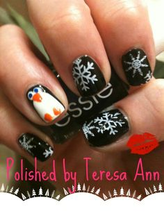 Since my blue snowflake nails ALREADY chipped, I decided to go for a black  white look. The penguin was an afterthought, but I think hes kid of cute.